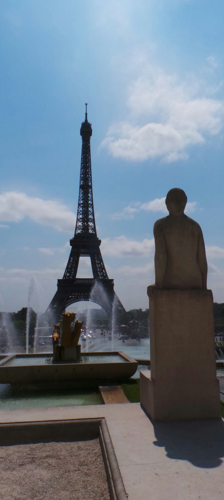 Statue looks out at the Eiffel Tower